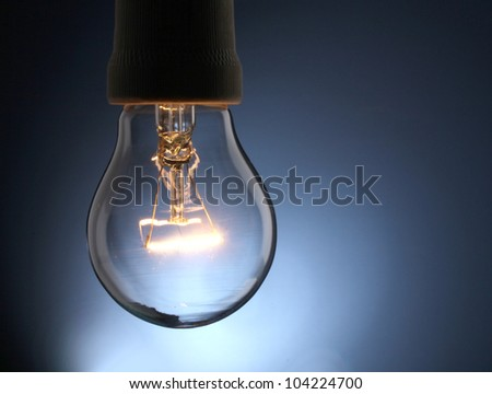 A lit light bulb isolated on white