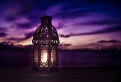 A lit up ramadan lamp against serene and beautiful evening sky. Ramadan background.