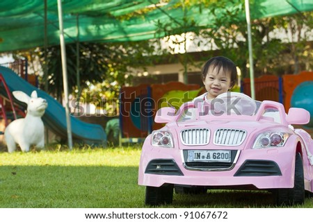 A little baby girl in Car Toy pink color