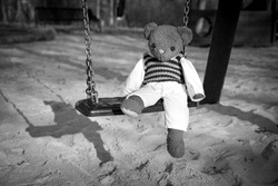 a little bear on a lonley playground
