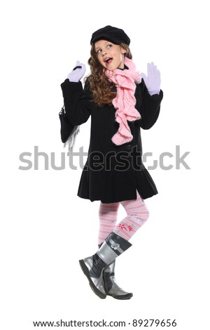 A little beautiful girl is in autumn clothes, isolated on a white background