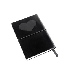 A little black book with a heart symbol on its leather cover isolated against white background.