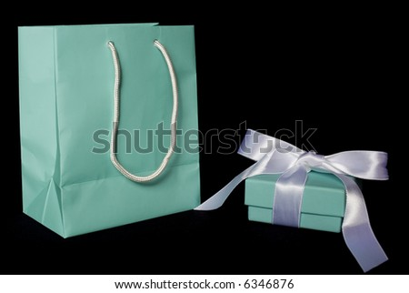 A little blue bag with matching gift box.