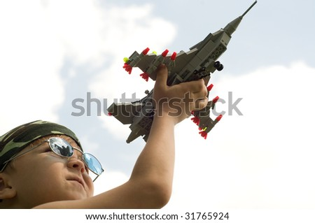 A little boy dreams of becoming a fighter pilot