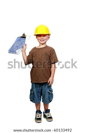 A little boy dressed for a construction job - stock photo