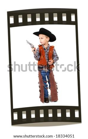 a little boy dressed up as a cowboy