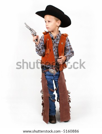 a little boy dressed up as a cowboy