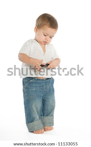 A little boy experimenting with a cellphone