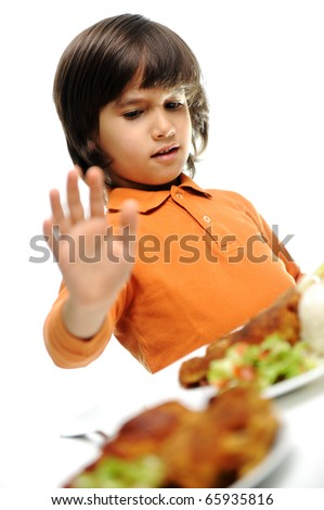 A little boy is heating a food, refusing food, kid does not want to eat