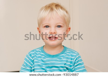 A little boy looking at the camera.