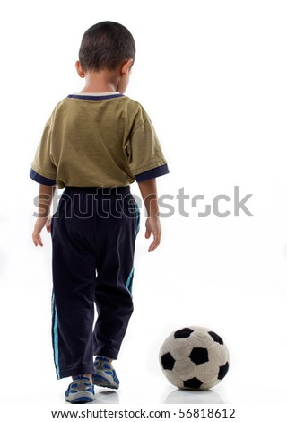 A little boy plays with soft ball on isolated background