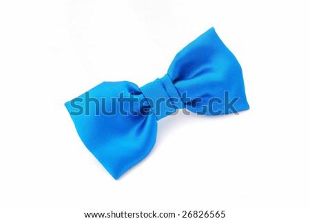 A little boy's blue bow tie isolated on white studio background