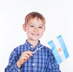 A little boy with argentinian flag on the white background
