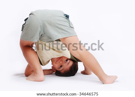 A little cute kid is playing isolated in white
