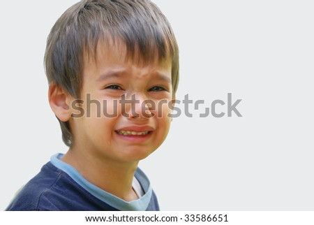 A little cute kid is truly crying and dropping big tears
