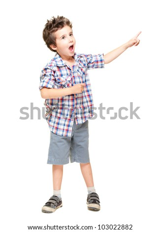 A little excited boy pointing at something isolated on white - stock photo