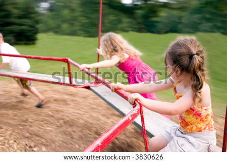 a little girl being spun on a merry-go-round