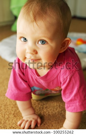 a little girl crawling on all fours