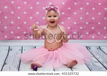 a little girl dressed up, smiled and had fun stock photo
