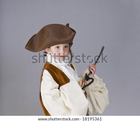A little girl dresses as a pirate for Halloween