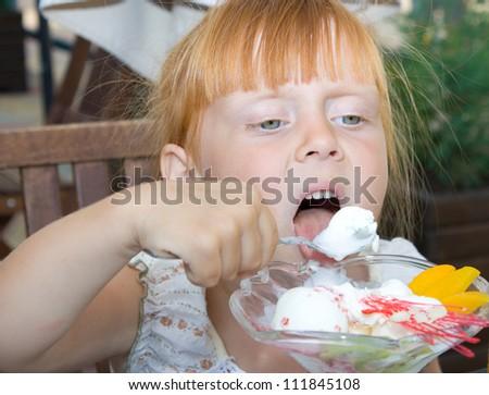 A little girl eating ice cream - stock photo