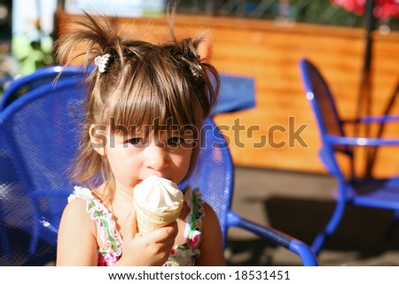 A little girl eating ice-cream