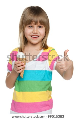 A little girl eating ice cream and holding her thumb up; isolated on the white background