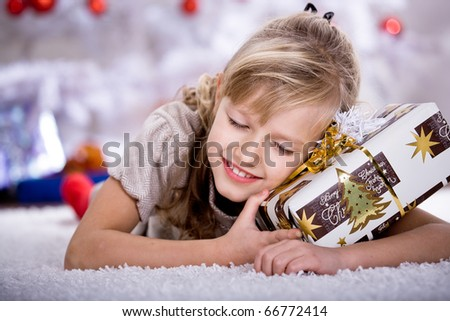 a little girl geting the Christmas gift