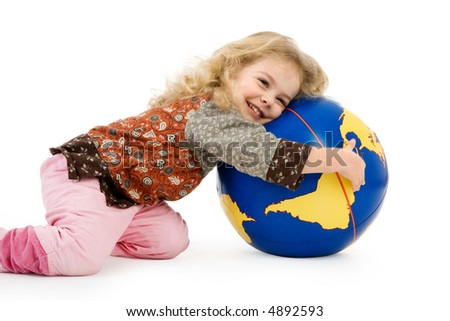a little girl holds a globe in her hands