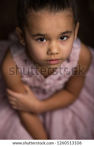 08599c0161ca Sad little girl sitting alone on the nature Images and Stock Photos ...