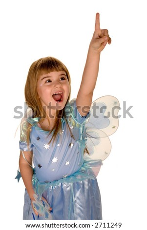 A little girl in fairy costume pointing up