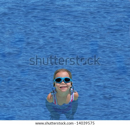 a little girl in goggles swimming in deep blue waters