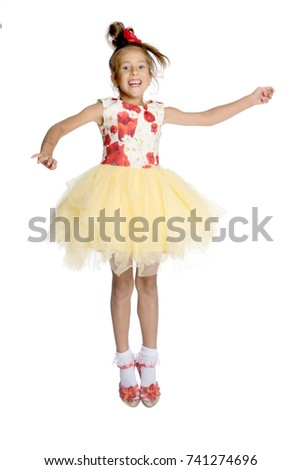 11d3d0e76 A little girl is jumping and waving her hands. The concept of a ...