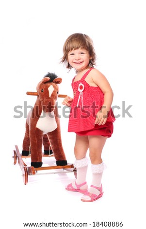 A little girl playing with a toy horse over white background