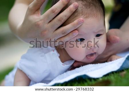 a little girl rise her head hard