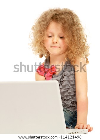 A little girl with a laptop, isolated on white background