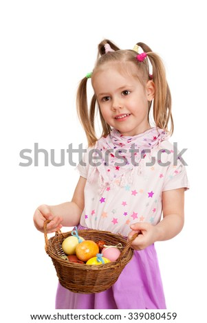 A little girl with basket of eggs for celebration of easter