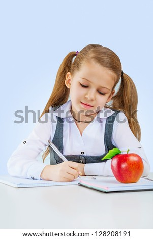 a little girl writing