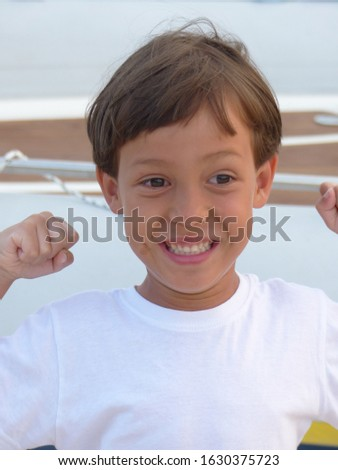 A little healthy Asian boy is cheerful with brown hair brown skin and brown eyes. A cute face and lovely smile.