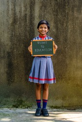 A little Indian School Girl, holding a Green Board written