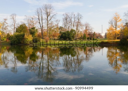 A little lake in the wonderful park of Boulogne in Paris; the Eiffel Tower can be seen at the distance