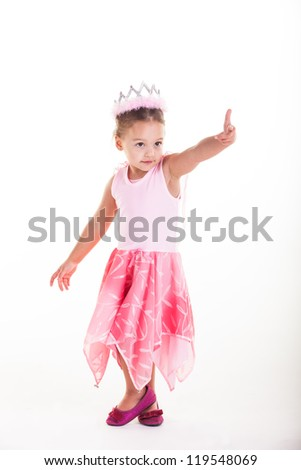A little princess pointing fingers toward someone.