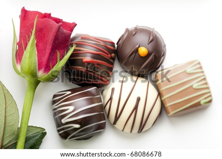 A little romance with a red rose and chocolate bon-bons.
