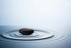 A little stone in water