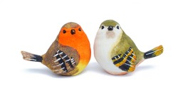 a little two ostrich birds ceramic isolate is on white background