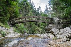 A little wooden bridge above a little river