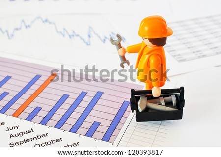 A little worker on a financial report