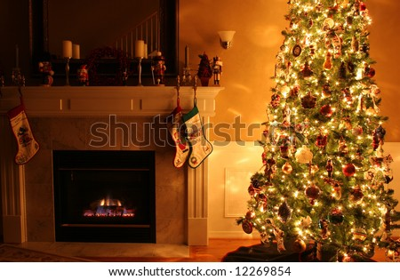 A living room at Christmastime lit only by the fire and Christmas tree.