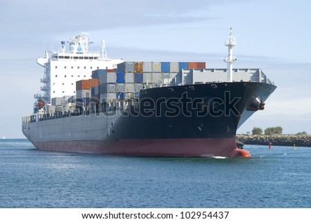 A loaded container ship coming into Fremantle Port in Western Australia. All insignia and logos have been removed.
