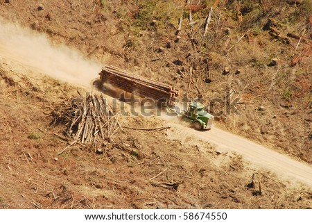 """A loaded log truck  on a logging operation or """"side"""" in the foothills of the Cascade Mountains in southern Oregon"""
